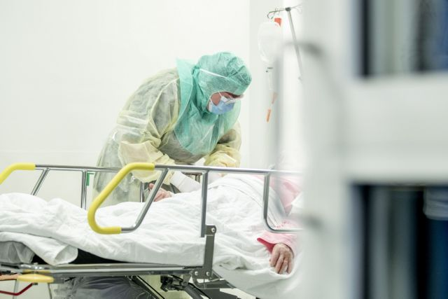 A nurse in protective gear takes a blood sample of a patient potentially infected with coronavirus disease (COVID-19) at the Turku University Hospital Tyks in Turku