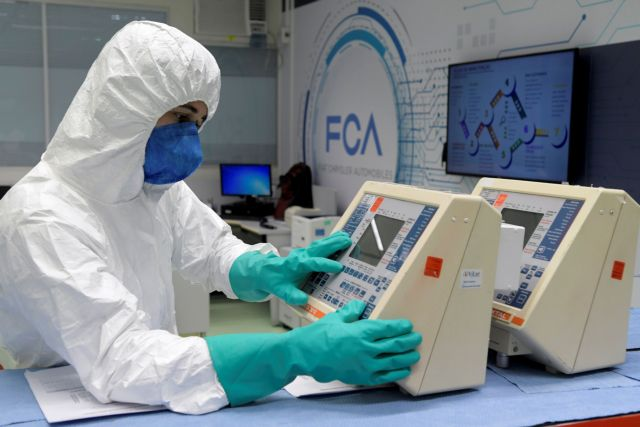 FILE PHOTO: A technician from FCA (Fiat Chrysler Automobiles) assembly plant fixes respirators for use in hospitals at the company's lab, amid the coronavirus disease (COVID-19) outbreak, in Betim