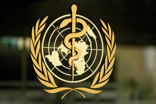 FILE PHOTO: The WHO logo is pictured at the entrance of its headquarters in Geneva
