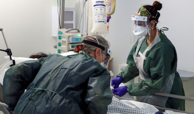 FILE PHOTO: Nurses care for a patient in an Intensive Care ward treating victims of the coronavirus disease (COVID-19) in Frimley Park Hospital in Surrey